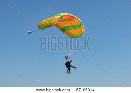 TYUMEN, RUSSIA - 13 AUGUST 2016: Airshow in Plekhanovo airport. Two parachutists on one parachute.