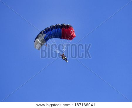 TYUMEN, RUSSIA - 13 AUGUST 2016: Airshow in Plekhanovo airport. Parachutist in the air.