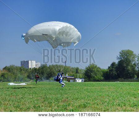 TYUMEN, RUSSIA - 13 AUGUST 2016: Airshow in Plekhanovo airport. Parachutist landing.