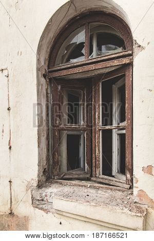 Elements of a ruined building close up. Doors and windows