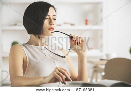 Thoughtful Woman With Spectacles