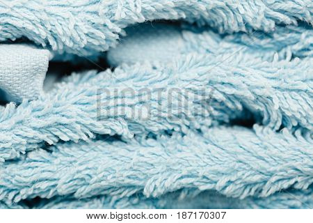 Detailed closeup of blue towel fabric surface. Patterns textures and background concept.