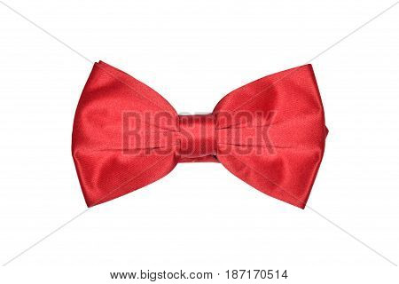 Overhead view of a red bowtie on a white background