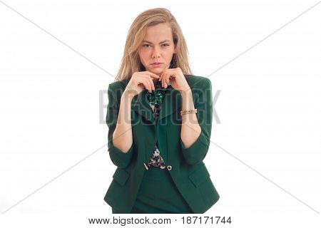 beautiful young blonde in green jacket looks languid gaze into the camera and holds hands near the face isolated on white background