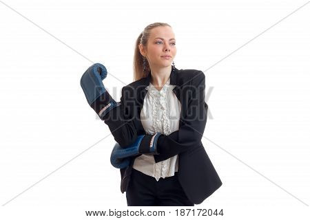 beautiful young girl in costume and boxing gloves looks up and poses on camera isolated on white background