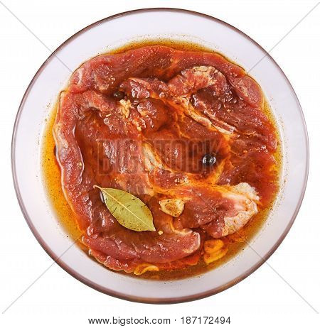 Meat Pork in marinade on a glass plate