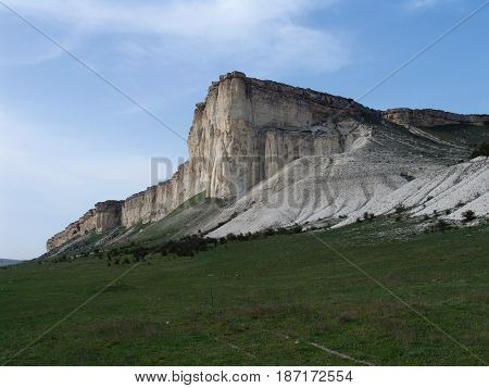 Summer landscape with a white rock in the valley of the sun in the morning. Crimea