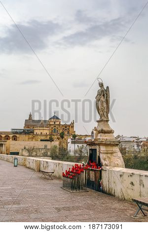 Sculpture of St. Raphael on Roman bridge in Cordoba Spain