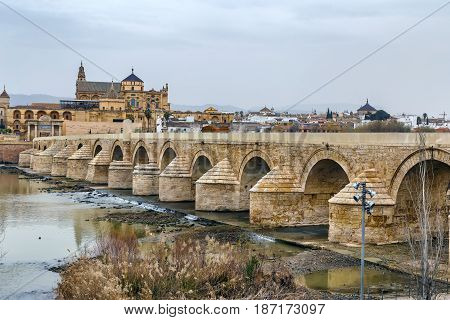 The Roman bridge and Guadalquivir river in the Historic centre of Cordoba Andalusia Spain
