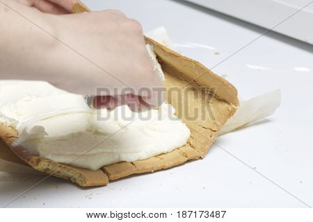Preparation Of Biscuit Rolls. Stages Of Preparation. The Woman Adds The Filling To The Biscuit.