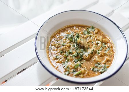 creamy spicy seafood fish soup with coriander herbs