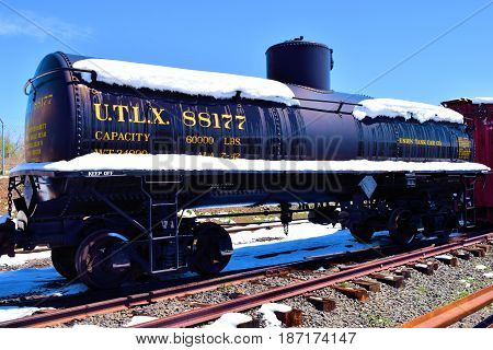 May 3, 2017 in Golden, CO:  Rail oil tank car in a railroad yard at the Colorado Railroad Museum where visitors can observe railroad cars and locomotives on display taken in Golden, CO