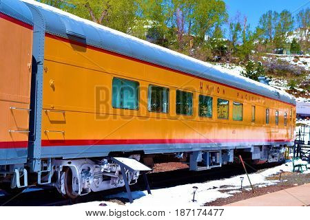 May 3, 2017 in Golden, CO:  Vintage passenger railroad car taken at the Colorado Railroad Museum where visitors can observe locomotives and railroad cars on display in Golden, CO