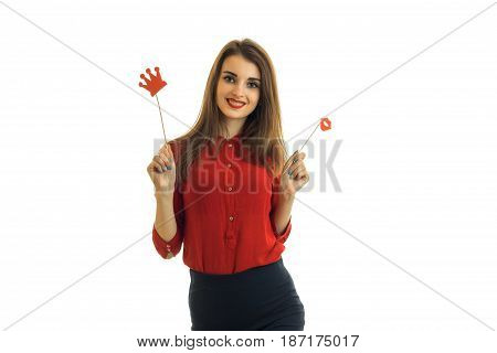 beautiful girl in frenzy red blouse looks into the camera and holds the paper Dummies for photo isolated on white background