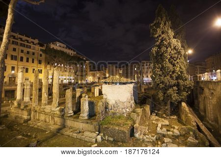 ROME, ITALY. January 06, 2015: Republican Roman temples, and the remains of Pompeys Theatre in Rome, Italy. Ancient Campus Martius. Night.