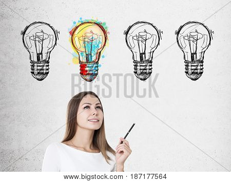 Inspired Woman With Pen And Four Light Bulbs