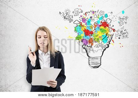 Blond Woman With Documents And Light Bulb
