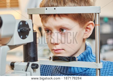 Children ophthalmology. Boy under optometrist test