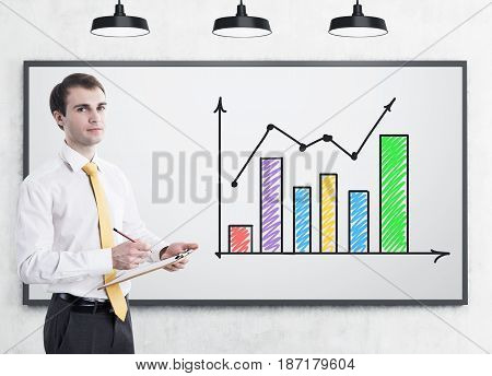 Man With Clipboard And Colorful Graph