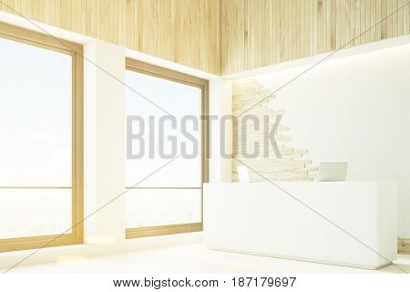 Side view of a light wood reception counter with two laptops and two tall square windows. 3d rendering mock up toned image
