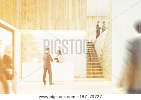Front view of an office lobby with business people a white reception counter and stairs. 3d rendering toned image