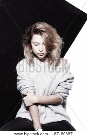Studio portrait of attractive caucasian girl, eyes closed