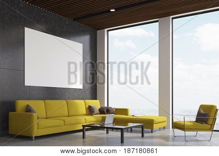 Side view of a living room with gray walls a yellow sofa and an armchair a laptop on a coffee table and a horizontal poster. 3d rendering mock up