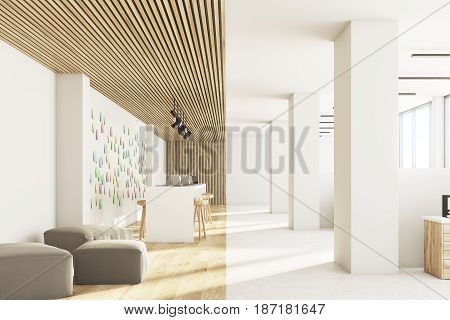 Front view of an open office interior with a bar table laptops standing on it light wooden ceiling and floor and a wall with sticky notes. 3d rendering