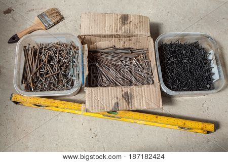 Nails and screws are in the plastic and paper boxes industrial level and brush