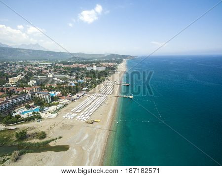 Aerial photograph of the beach and the blue sea and mountains Antalya