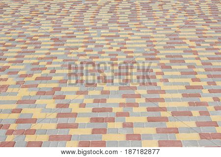 texture of colored pavement made by cobbles