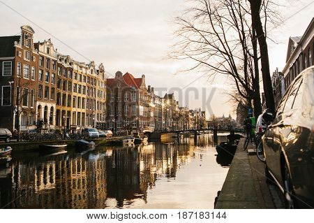 Amsterdam, Netherlands, January 2, 2017: View of traditional houses in Amsterdam Netherlands Europe. Sunset. Evening European style houses
