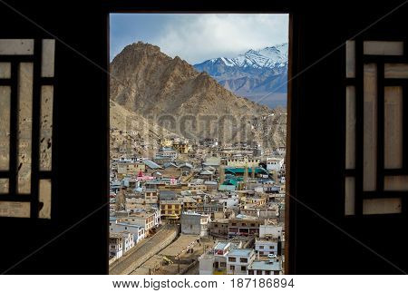 The city of Leh through windows from Leh Palace