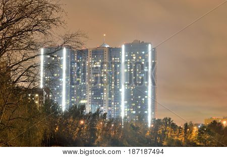 Contemporary residential skyscraper at night on the outskirts of St. Petersburg Russia.