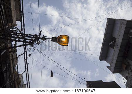 turn on of light on lamp post in Old delhi city Delhi India