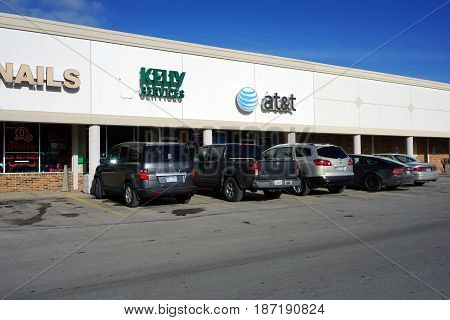 BAY VIEW, MICHIGAN / UNITED STATES - NOVEMBER 26, 2016: One may apply for employment at Kelly Services, and sign up for AT&T communication services, in a Bay View strip mall.