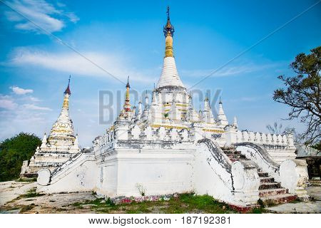 The brick yellow Maha Aung Mye Bon Zan monastery on the Inwa royal site Inn Wa, near Mandalay. (Burama)