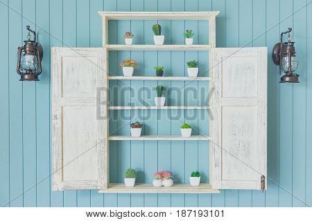 Blue Wood With Small Garden Home Decoration. Green Ocean Color Wooden Wall With Plant Pot On The Win