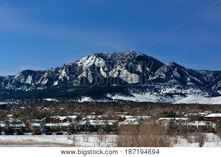 Flatirons Mountains in Boulder Colorado on a Cold Snowy Winter Day
