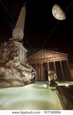 Pantheon, historic building landmark in Rome, Italy. Night. Commissioned by Marcus Agrippa during the reign of Augustus (27 BC - 14 AD) and rebuilt by the emperor Hadrian about 126 AD. Big half moon.