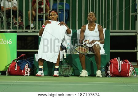 RIO DE JANEIRO, BRAZIL - AUGUST 7, 2016: Olympic champions Serena and Venus Williams of USA in action during doubles first round match of the Rio 2016 Olympic Games at the Olympic Tennis Centre