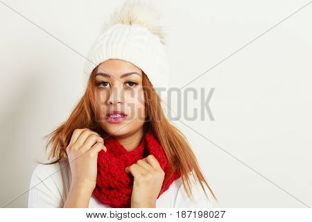 Fashion snowy time people concept. Woman with red winter clothing.   model wearing warm cap and scarf
