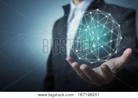 Businessman holding global circle business network connection concept