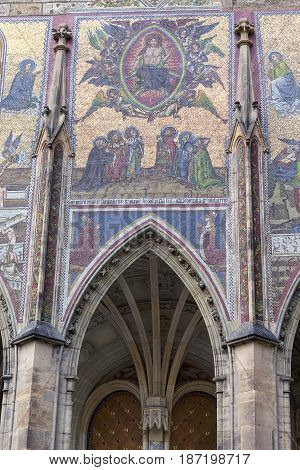 14th century St. Vitus Cathedral facade mosaic Last Judgment Prague Czech Republic. It is a Roman Catholic metropolitan cathedral in Prague the seat of the Archbishop of Prague.