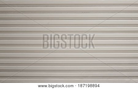 Old white zinc wall texture or old metal texture background. Steel door horizontal with pattern for design.