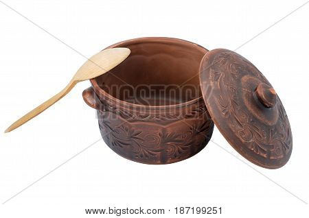 Clay pan and wooden spoon isolated on white background