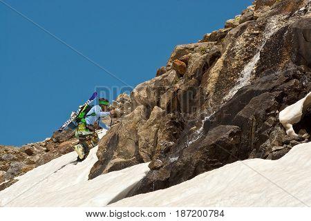 Freerider climbing a mountain Caucasus Elbrus summer