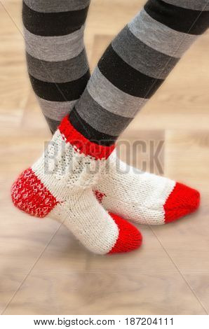 White red wool socks on his legs