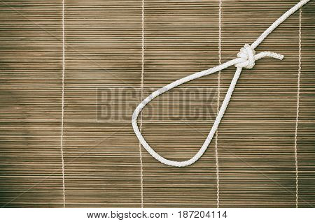 noose of rope on a wooden background