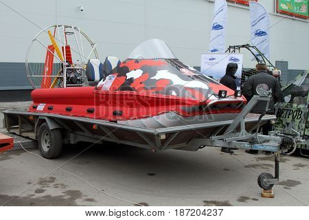 PERM RUSSIA-APRIL 14 2017: Red Hovercraft on the trailer for transportation. Russia. Perm.